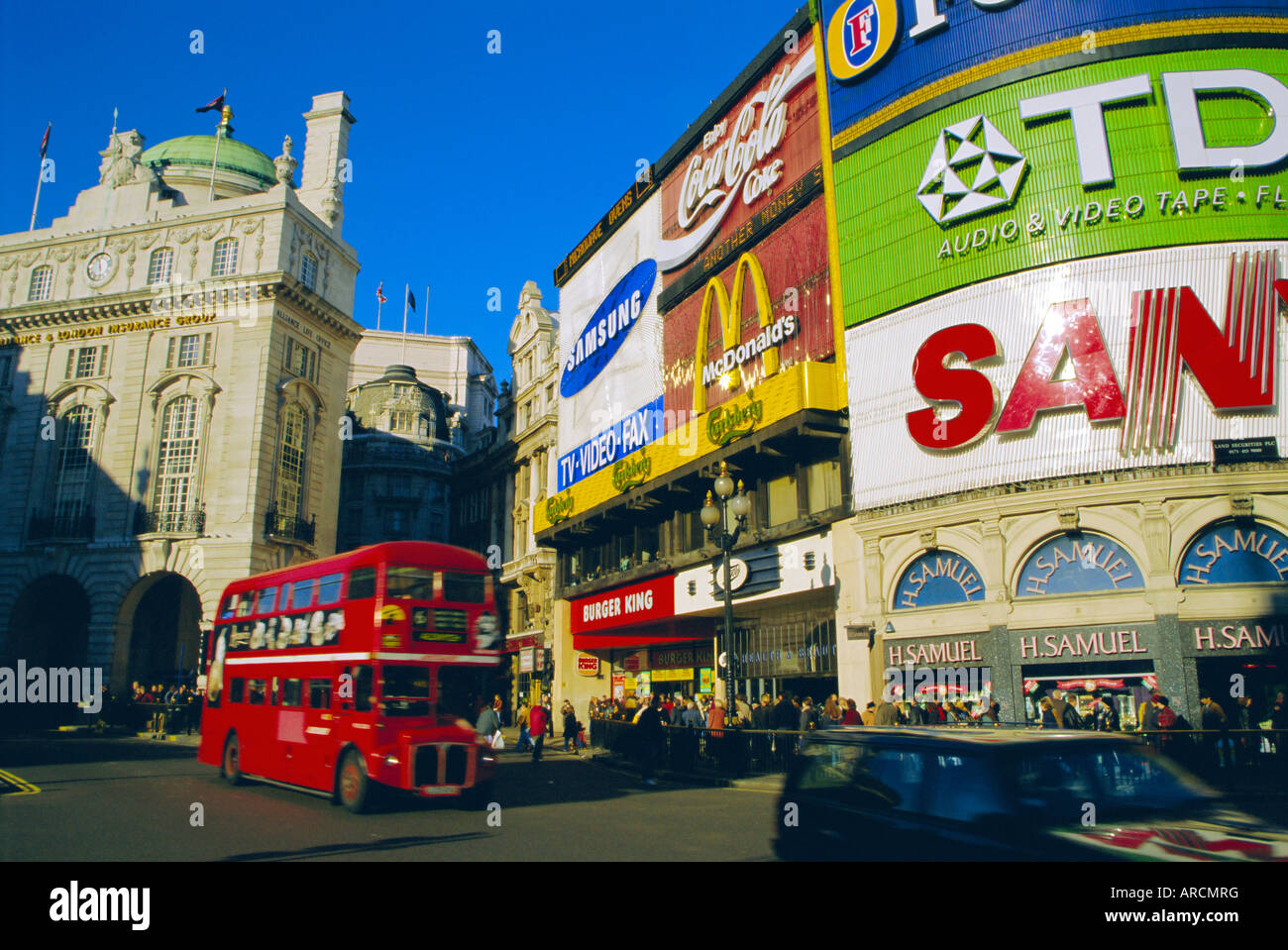 Double decker bus and advertisements, Piccadilly Circus, London, England, UK - Stock Image