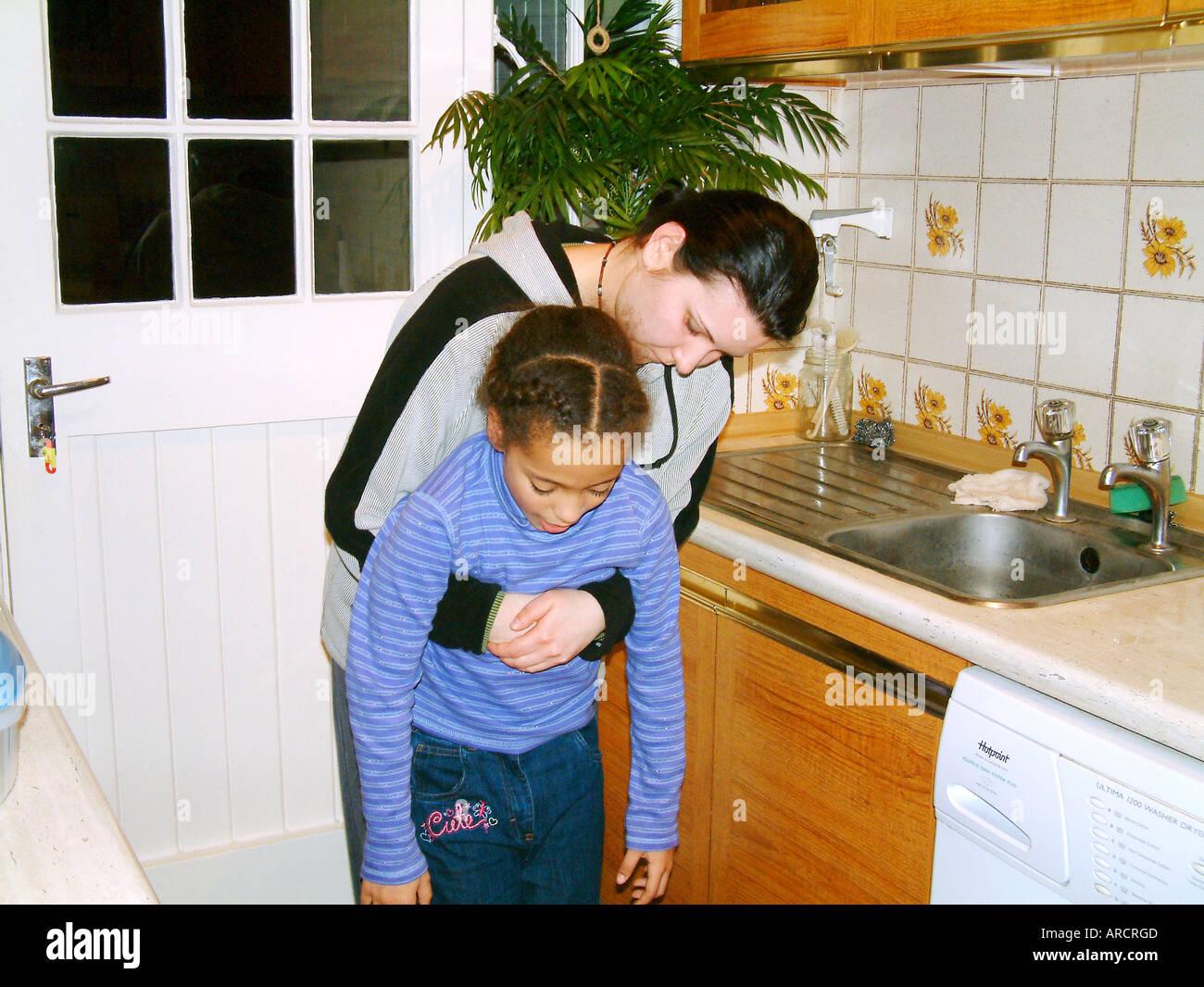 Choking - Heimlich manoeuvre - Stock Image