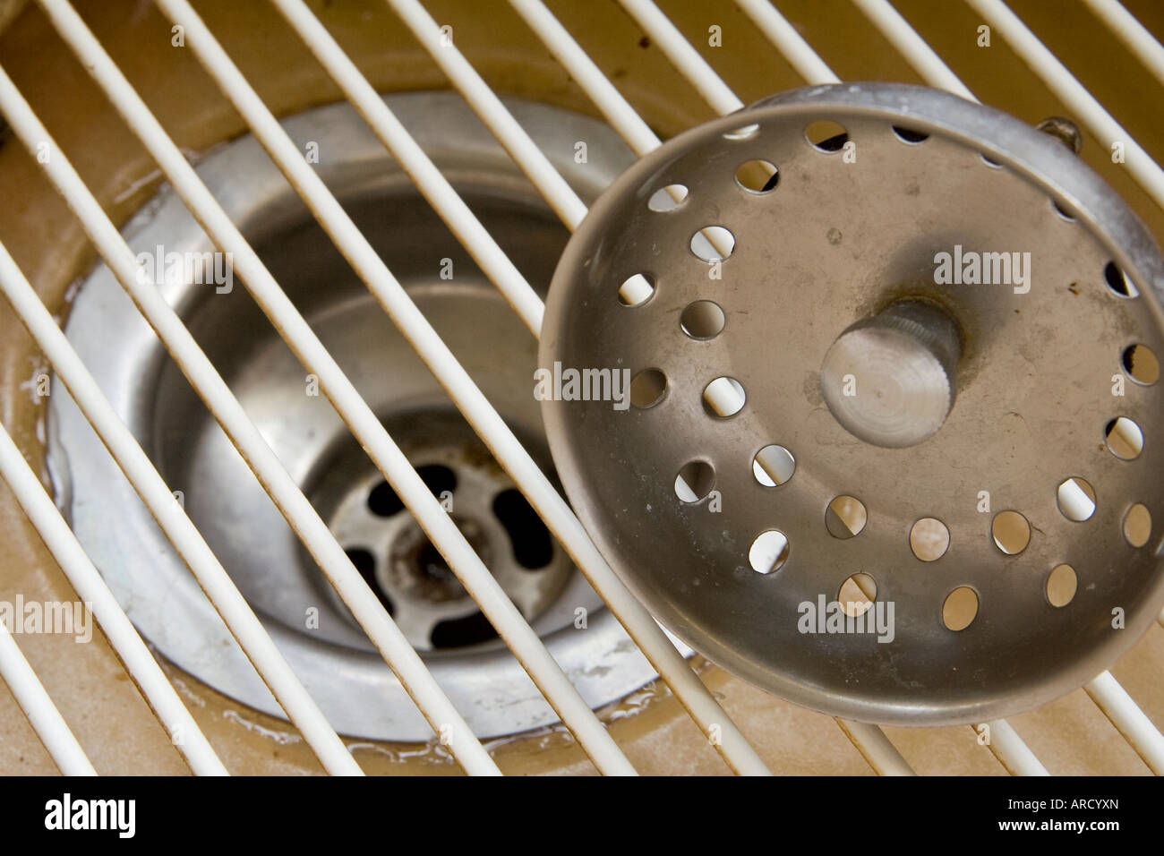 ^Plug hole, metal ^plug and ^drainer in a kitchen ^sink - Stock Image