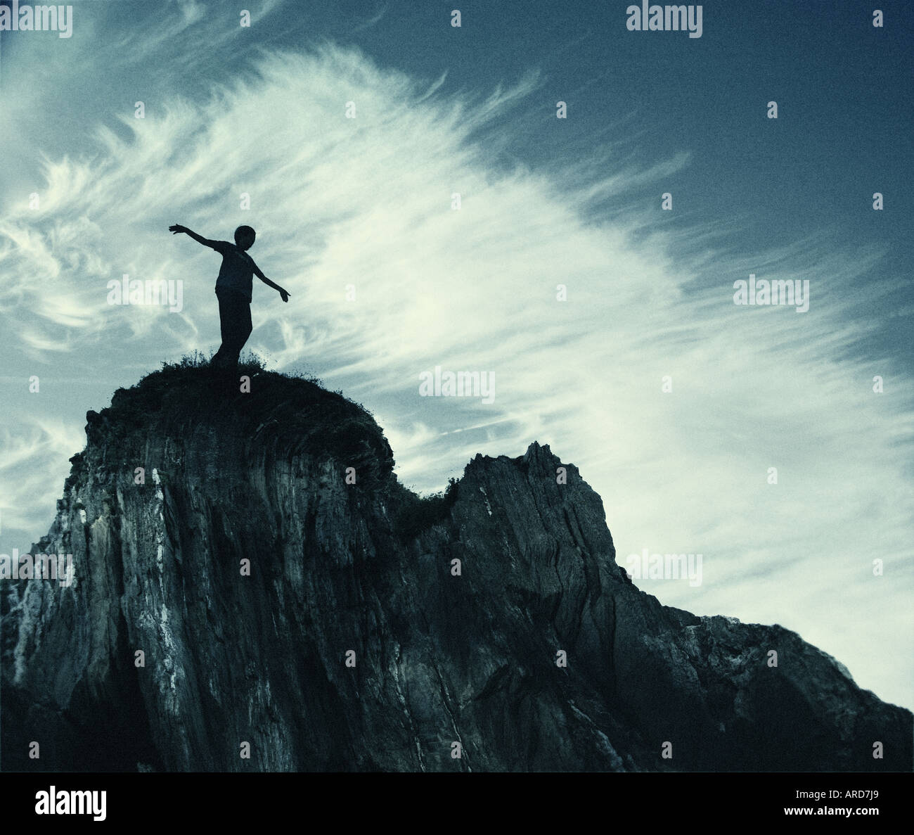 figure stood at top of cliff - Stock Image