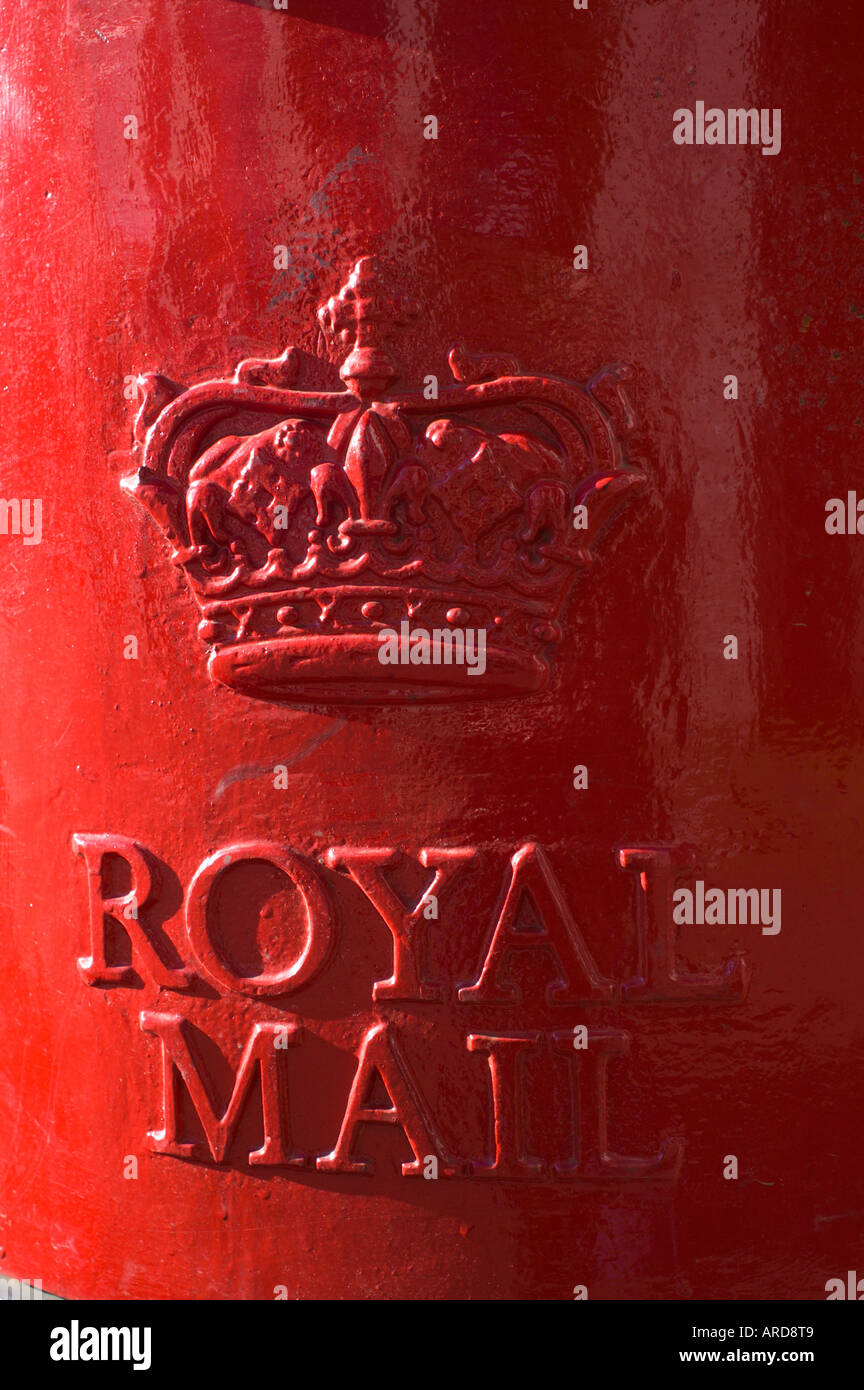 Red post box Britain with royal crest - Stock Image