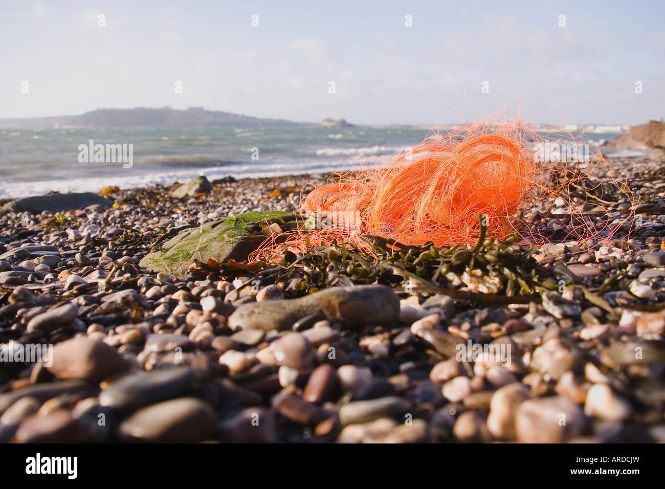 Rubbish on a beach - Stock Image