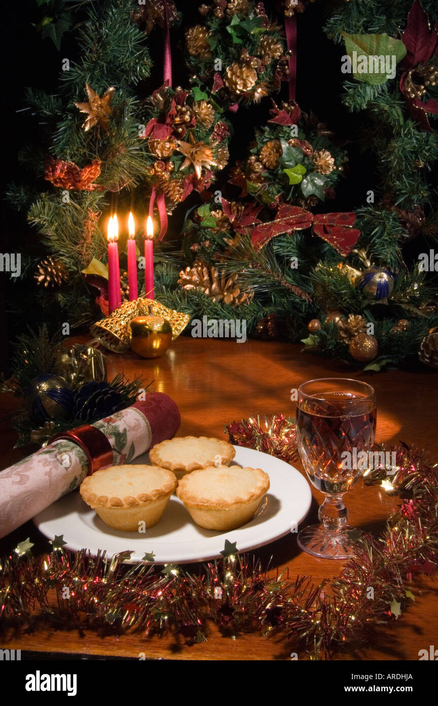 Santa's Treat for supper: Shop bought mince pies with a glass of SHERRY in a Waterford cut glass - Stock Image