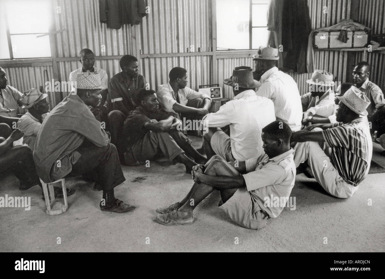 Detainees listen to a radio in Wha Wha, a detention camp in Ian Smith's illeglly declared Rhodesian republic - Stock Image