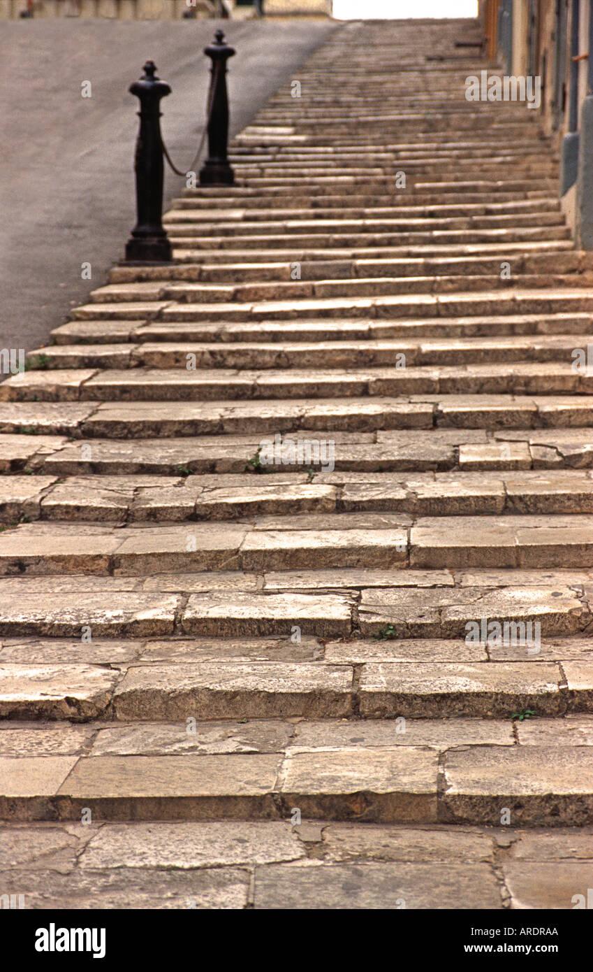 Sandstone steps in a Valletta street Malta Europe Public footpath Valletta is a city of steps - Stock Image