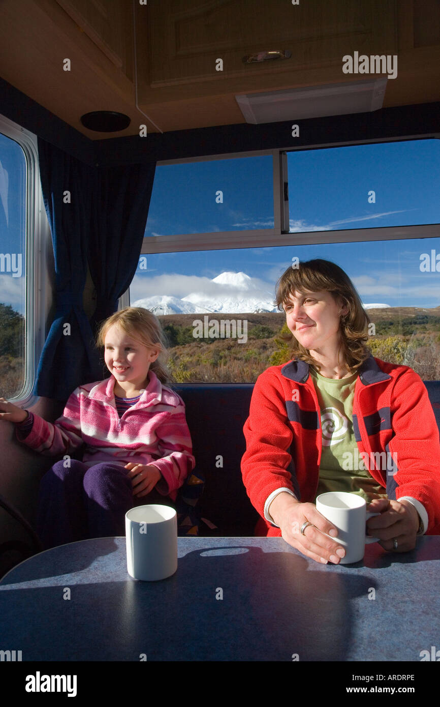 Mother and Daughter in Campervan and Mt Ngauruhoe Tongariro National Park Central Plateau North Island New Zealand - Stock Image