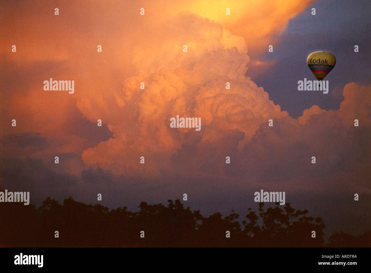 Hot Air Balloon and Storm Clouds sunset Stock Photo