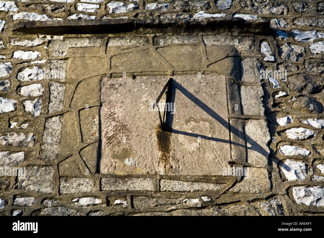SUN DIAL MOUNTED ON WALL BRASSINGTON DERBYSHIRE ENGLAND - Stock Image