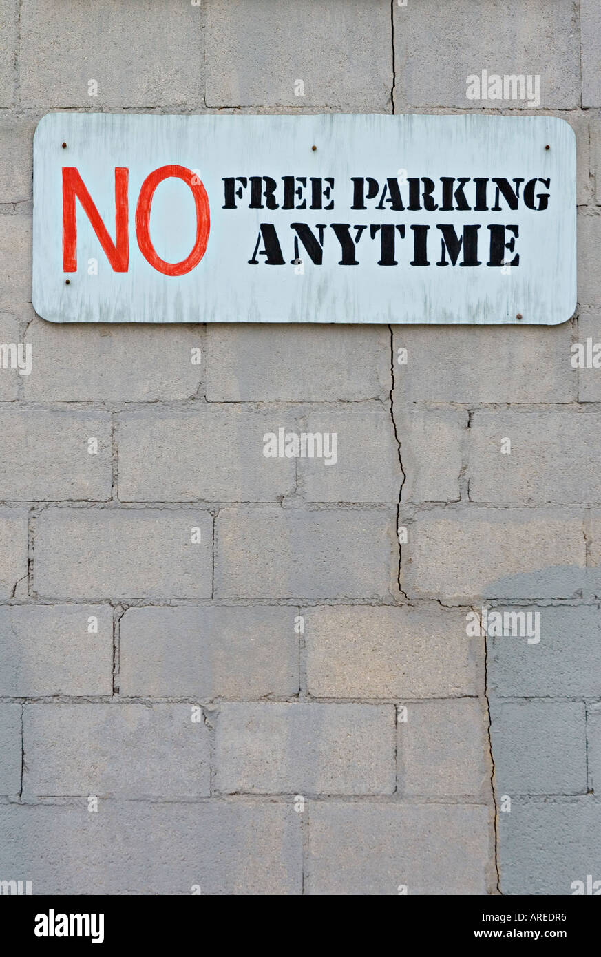 NO FREE PARKING ANYTIME sign - Stock Image