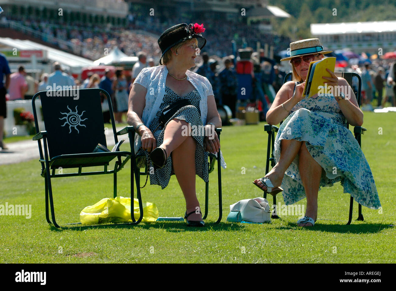 Two ladies enjoying the atmosphere at the Glorious Goodwood race meeting Picture by Andrew Hasson July 31st 2007 - Stock Image