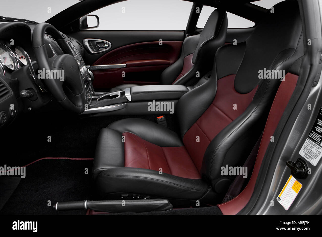 2006 aston martin v12 vanquish s in silver - front seats stock photo