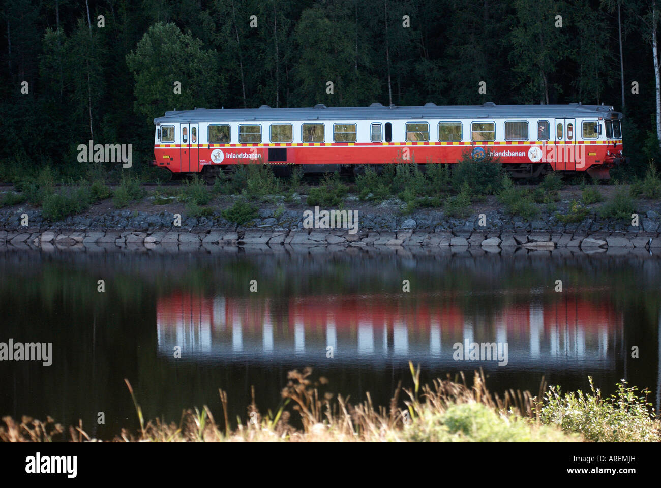 A train of the Swedish Inland Railway at a lake shore Tansjoborg Dalarna Sweden August 2007 - Stock Image