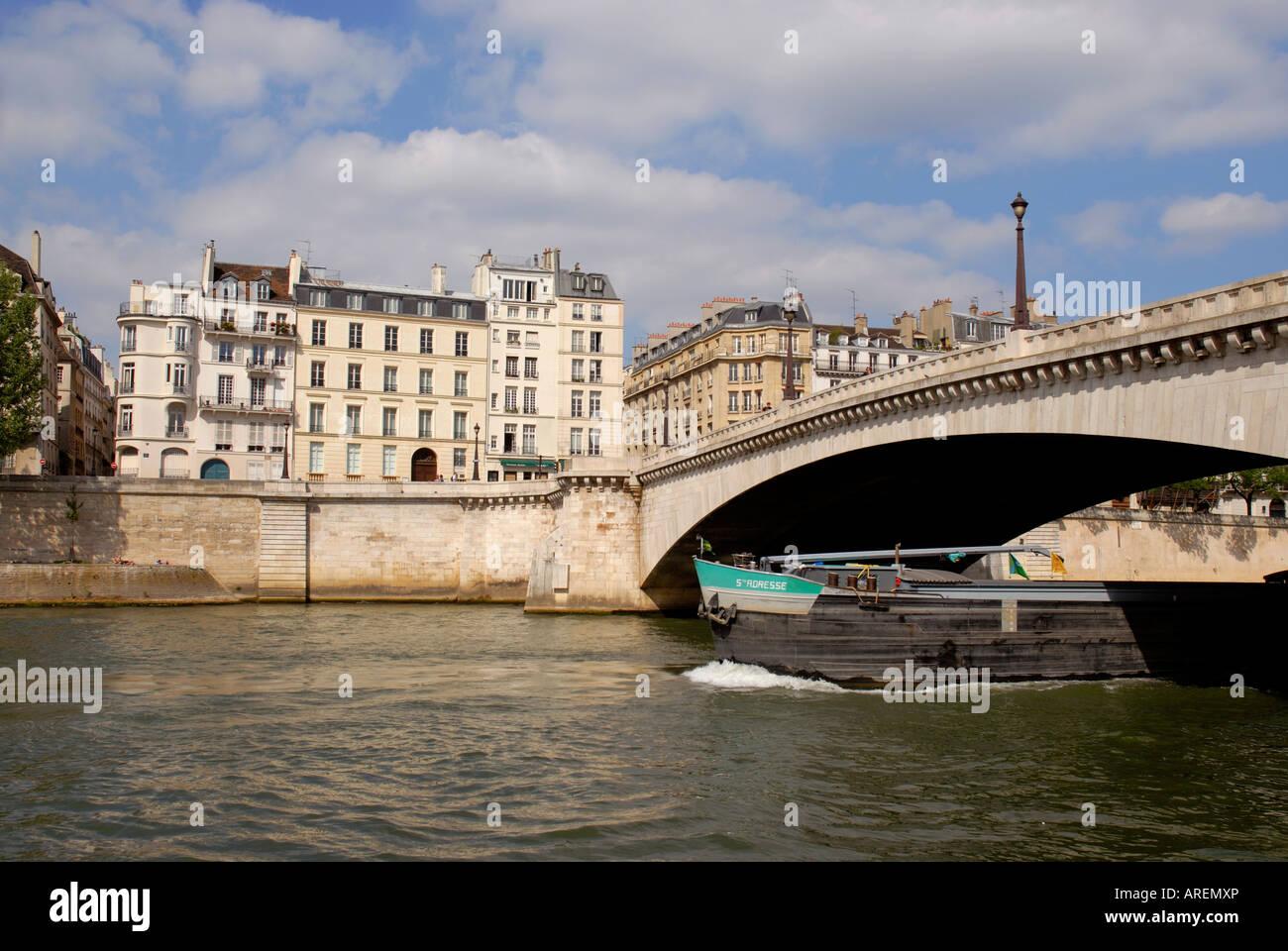 Ile Saint Louis island Seine river Pont de la Tournelle bridge Old Paris France - Stock Image