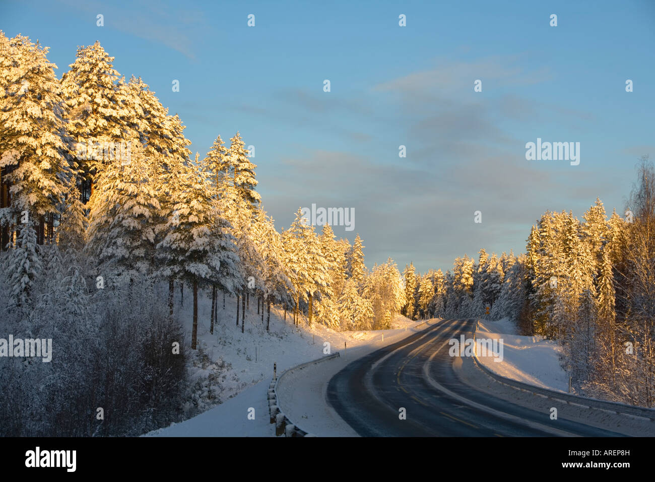 Empty Finnish highway ( valtatie 9 , Highway 9 , E63 ) at evening light at Winter Finland - Stock Image