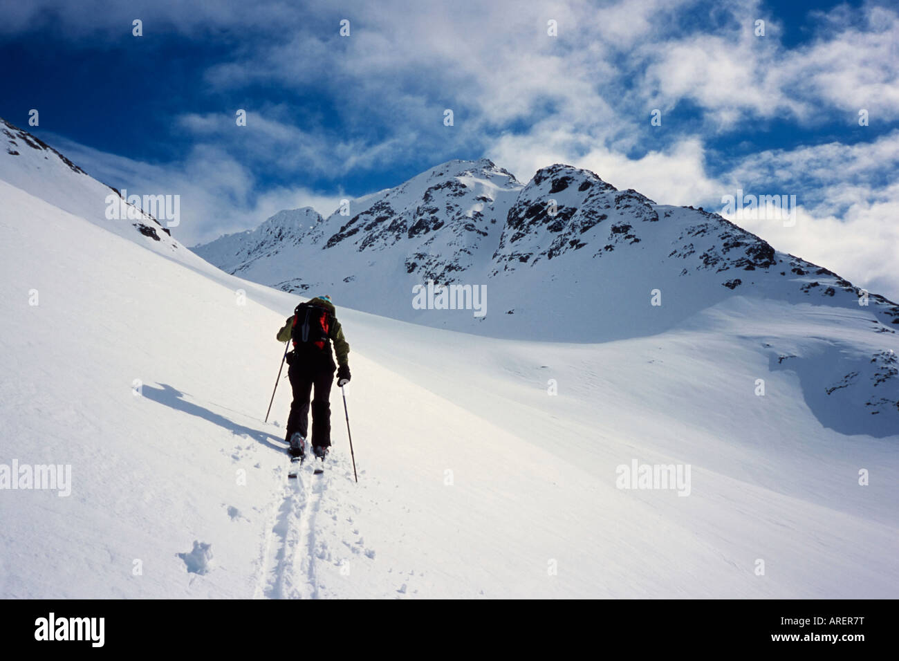 Telemark skier climbing the gentle slopes of Sofiatinden in the Lyngen Alps, arctic Norway - Stock Image