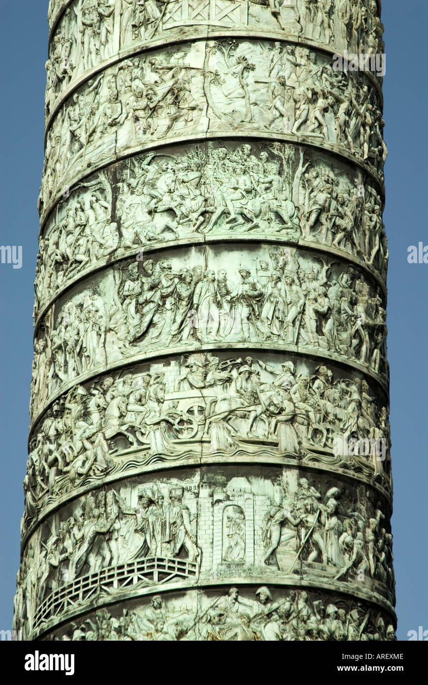 The Austerlitz Column in Place Vendome featuring Napoleon's Military exploits Paris France - Stock Image