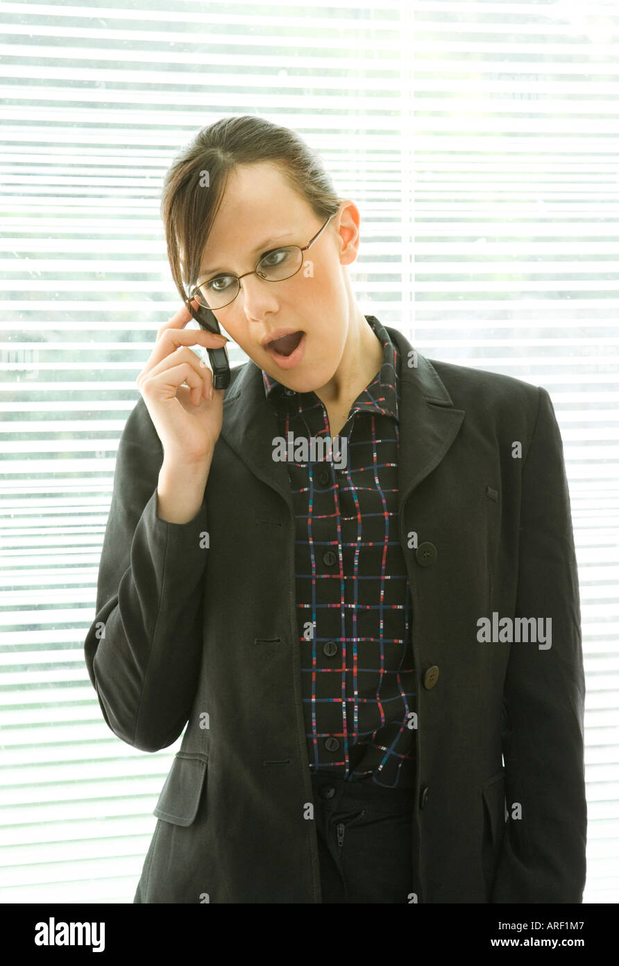 a woman speaking on a mobile phone - Stock Image