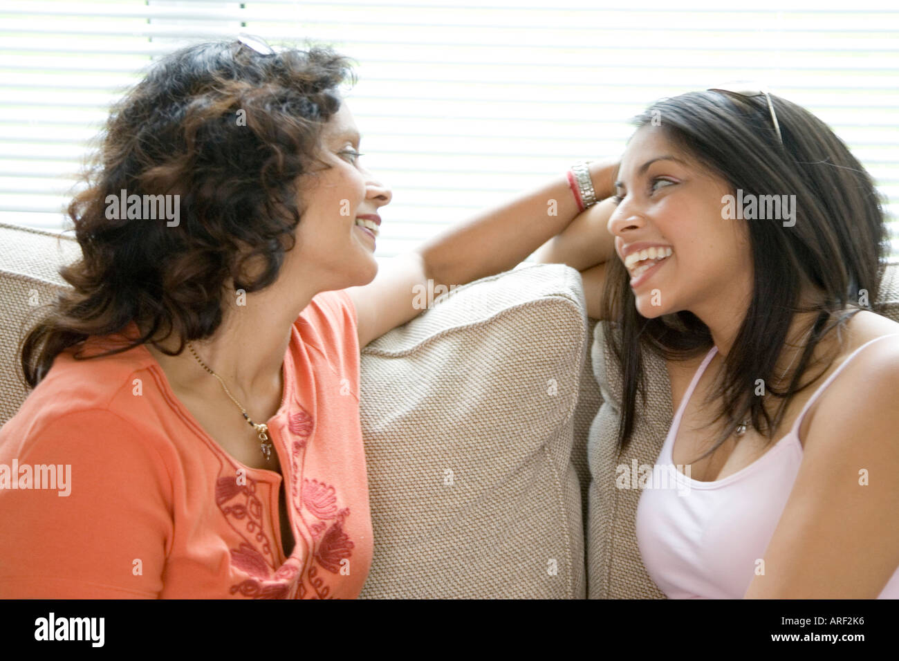 mother and daughter chatting - Stock Image