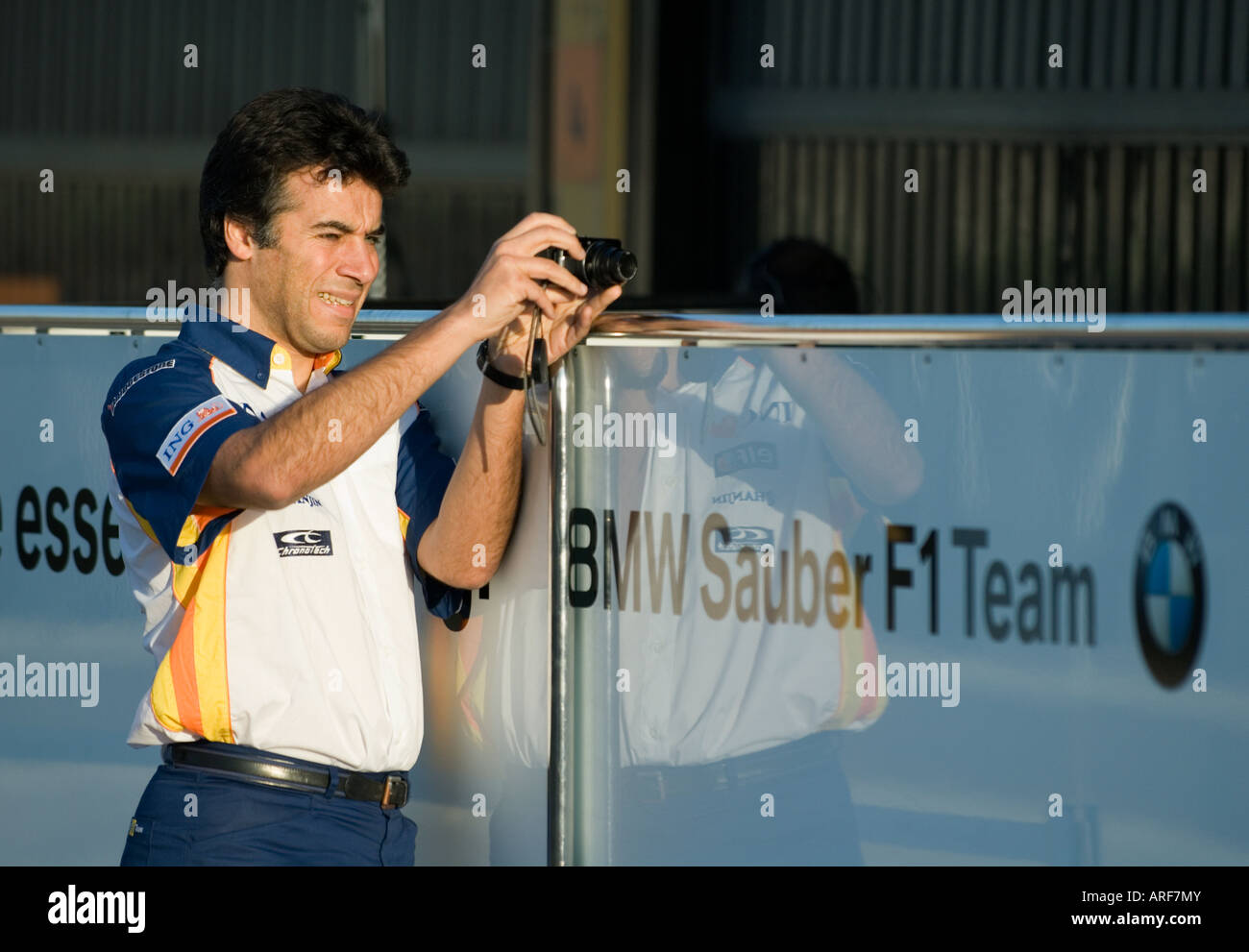 Renault Team member takes pictures of BMW Sauber box during Formula 1 Testing on Circuit Ricardo Tormo, Jan.2008 Stock Photo