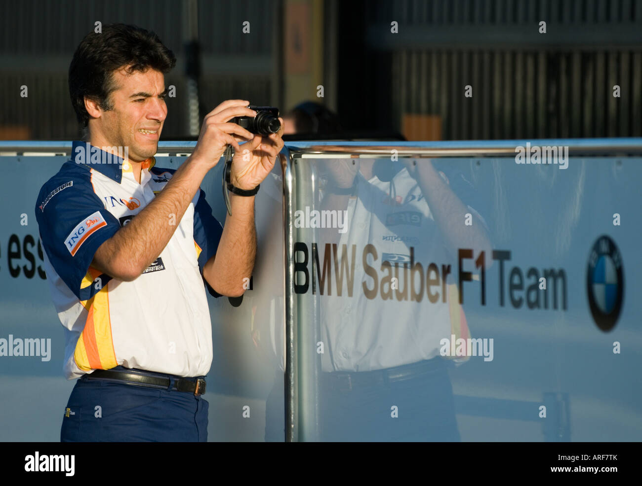 Renault Team member takes pictures of BMW Sauber box during Formula 1 Testing on Circuit Ricardo Tormo, Jan.2008 Stock Photo