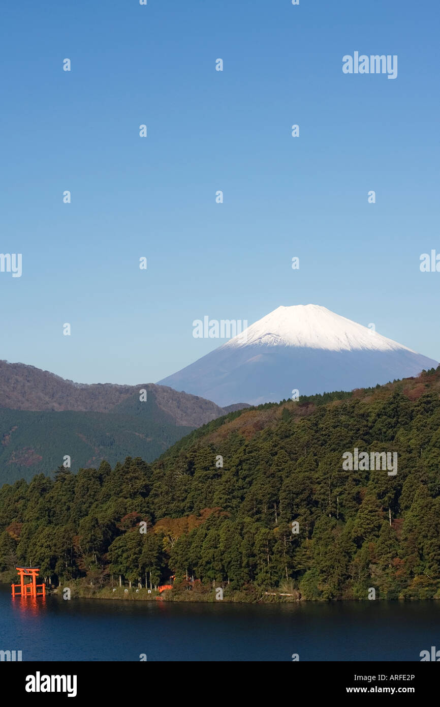 Red torii gate and distant view of Mt Fuji from Lake Ashi Kanagawa prefecture Japan - Stock Image