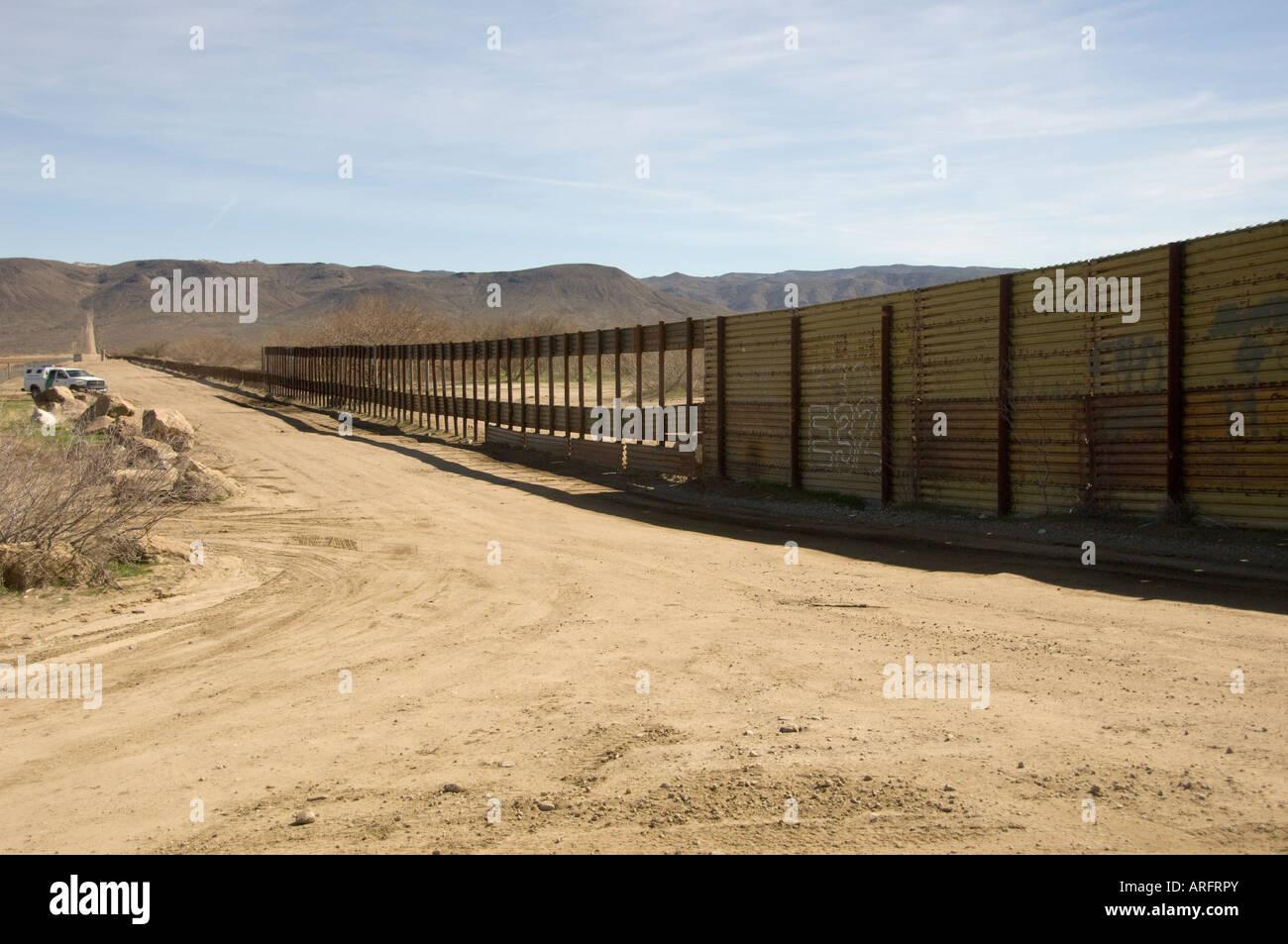 Mexico Border Fence with Holes at Jacumba, California - Stock Image