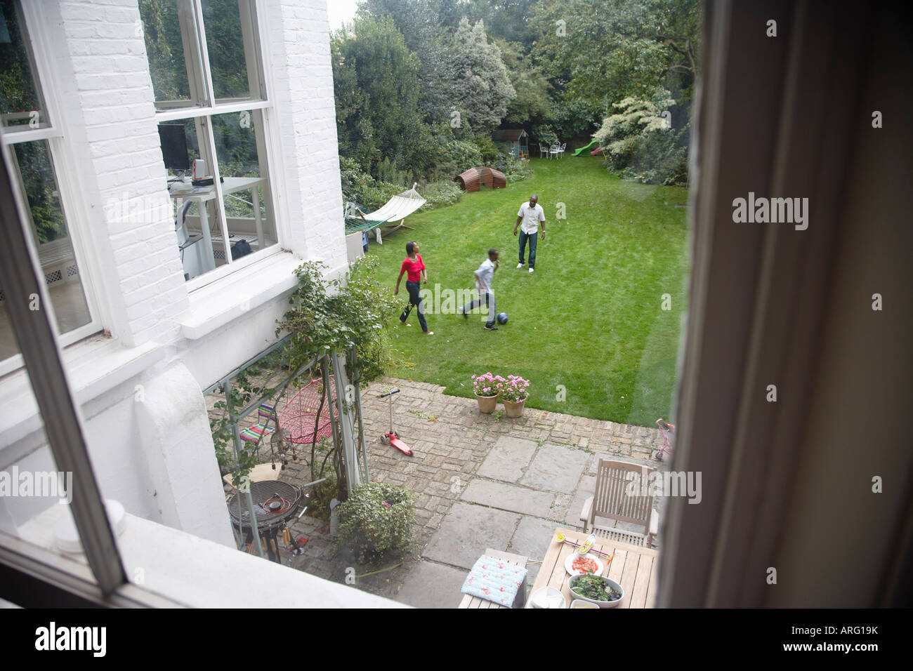Family Playing in Backyard Stock Photo