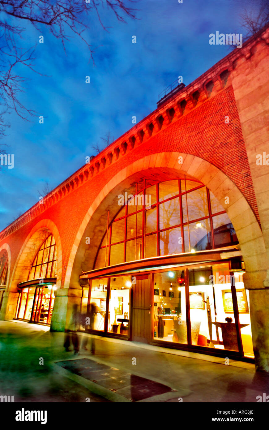 Paris France, Shopping Renovated Railroad Overpass, Small Shops, 'Viaduc des Arts' Night, Christmas Light Decorations - Stock Image