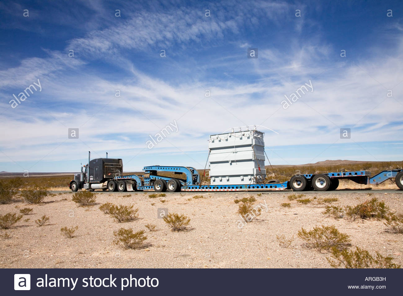truck hauling wide load oversize load over size load low boy lowboy electrical  transformer - stock