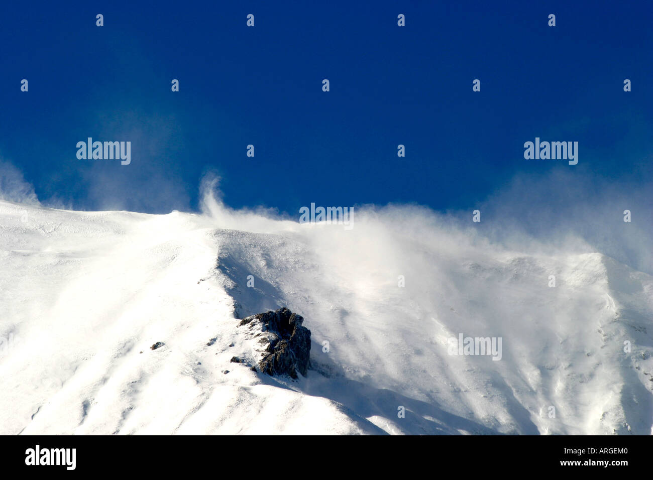 Winter snow blows on the dramatic mountains of the Sibillini National Park which spans Le Marche and Umbria in Italy Stock Photo