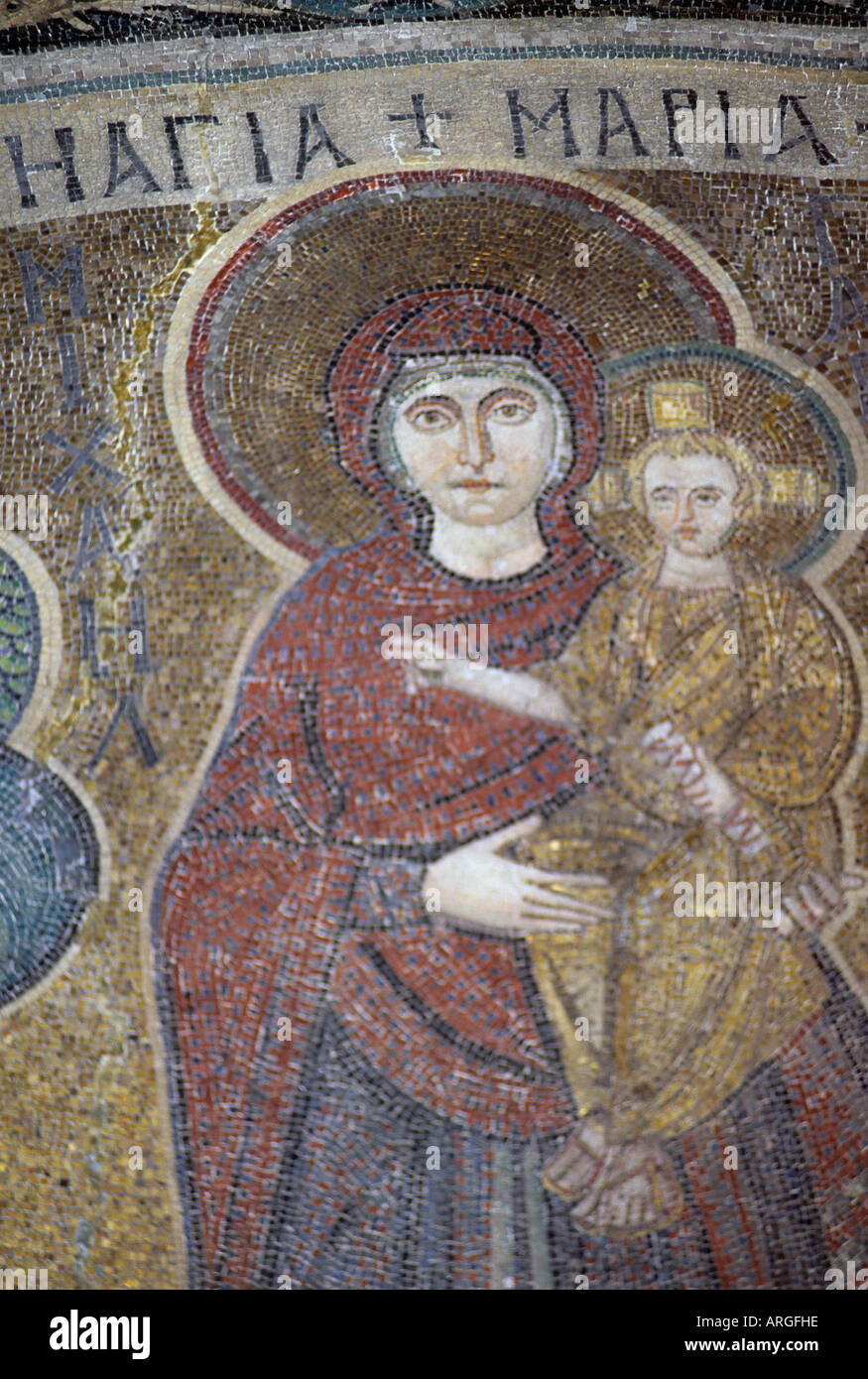 Detail of the Byzantine mosaic depicting the Virgin Mary bearing the infant Jesus in the domed roof of the semi Stock Photo