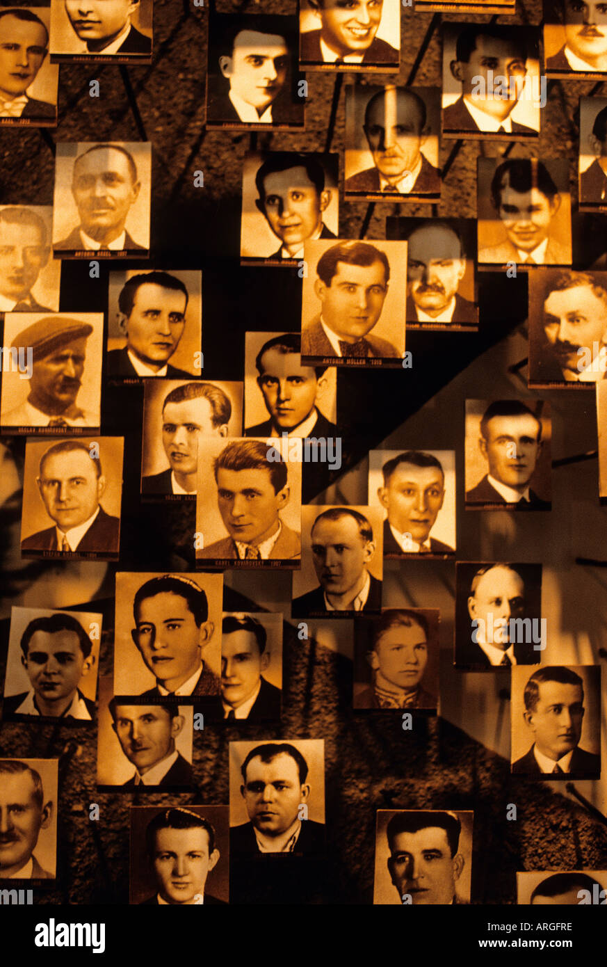 Detail of a collage composed of portraits of those men who died on the site of a horrific massacre in June 1942 Stock Photo