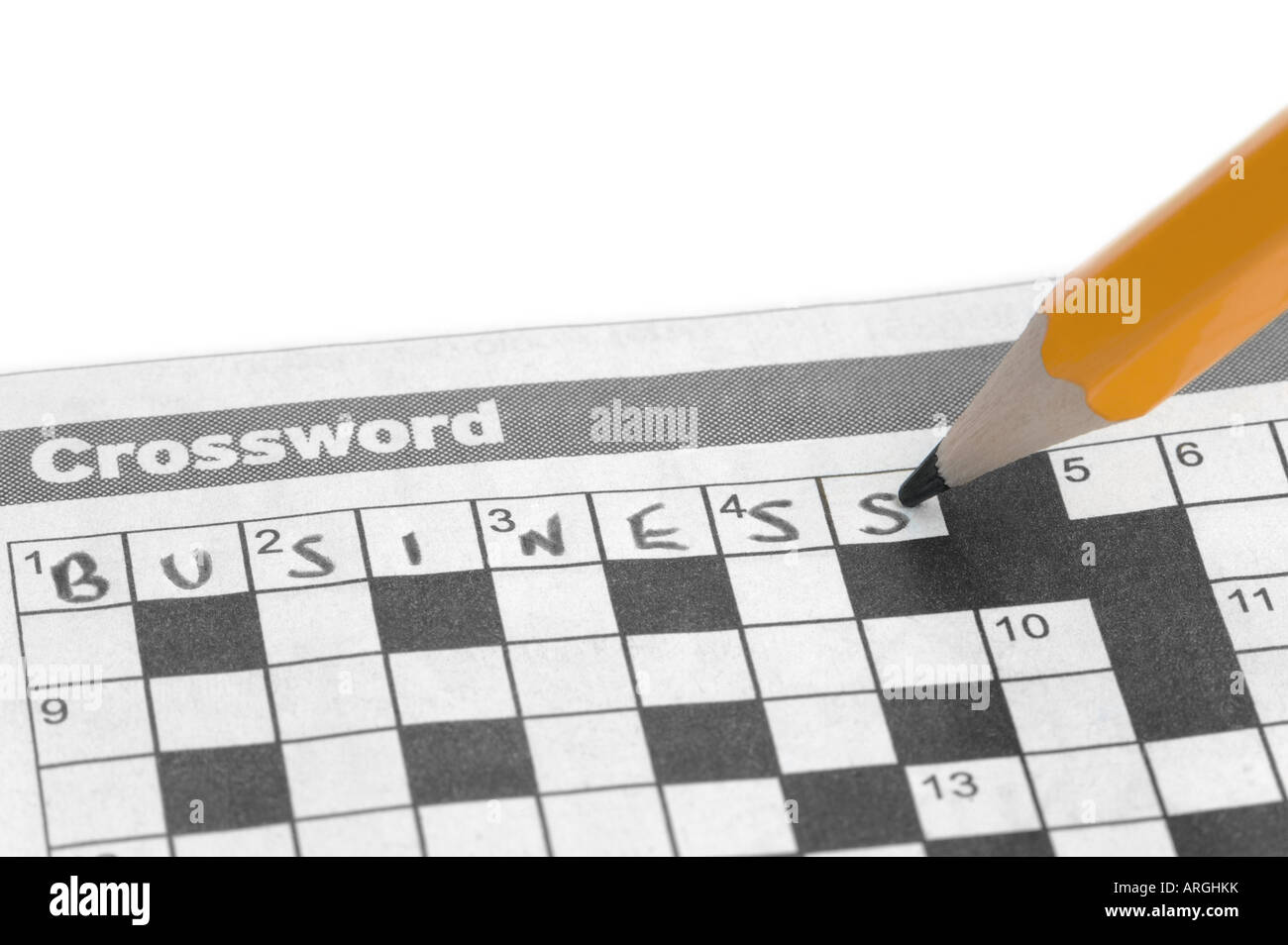 Business written on a crossword with a yellow pencil - Stock Image