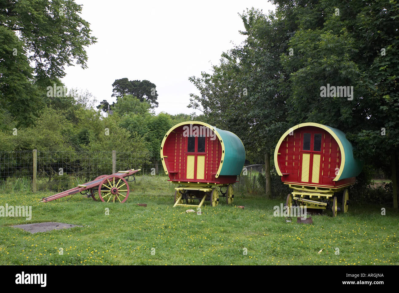 horse drawn irish gypsy travellers wagons in a field Bunratty Folk Park County Clare Republic of Ireland - Stock Image