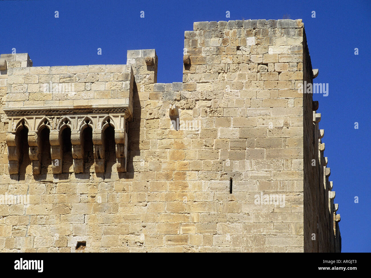 The machicolations and crenels of Kolossi Castle built in 1302 by the Knights of St John - Stock Image