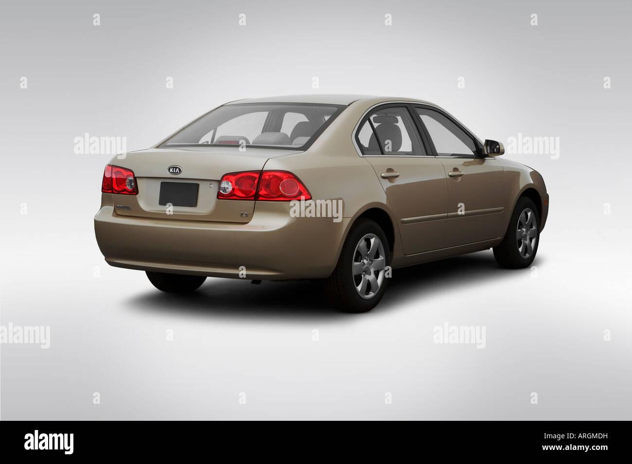 2007 Kia Optima LX In Beige   Rear Angle View   Stock Image