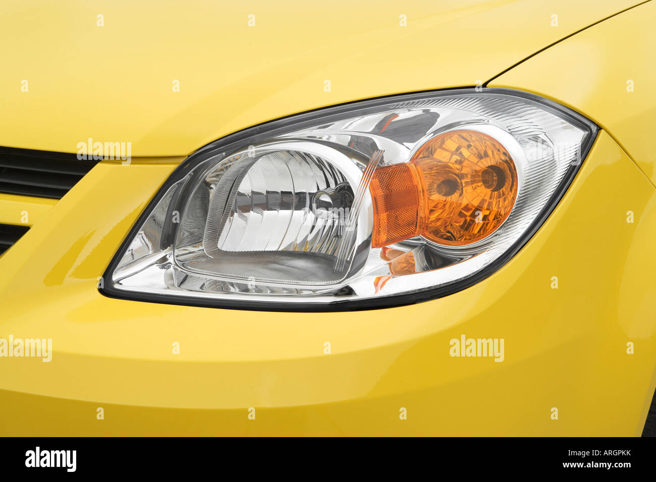 2007 Chevrolet Cobalt LS in Yellow - Headlight - Stock Image