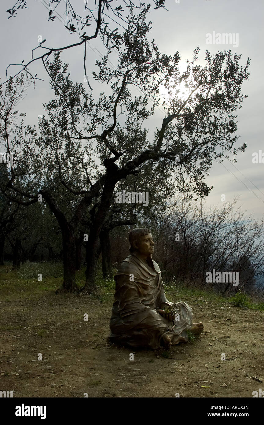 The bronze sculpture of Saint Francis in meditation made from the Italian artist Fiorenzo Bacci near the convent - Stock Image