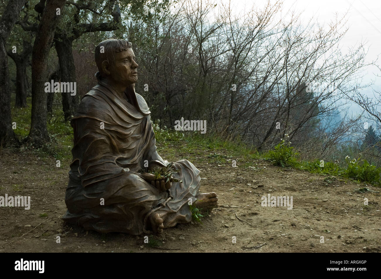 The bronze sculpture of Saint Francis in meditation made from the Italian artist Fiorenzo Bacci - Stock Image