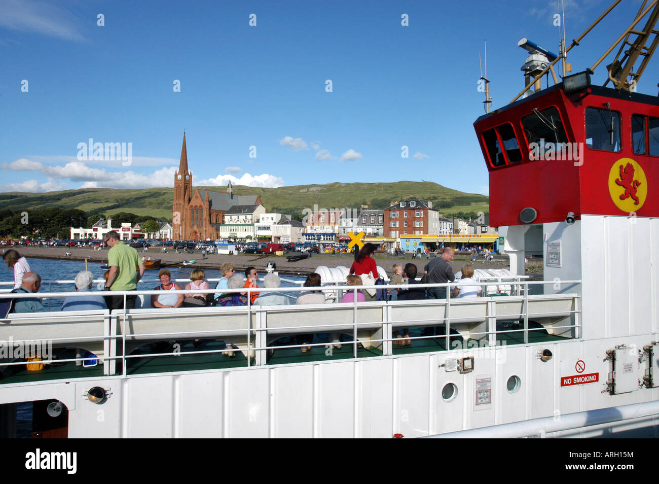 Largs to Isle of Cumbrae Cal Mac ferry with Largs in background - Stock Image