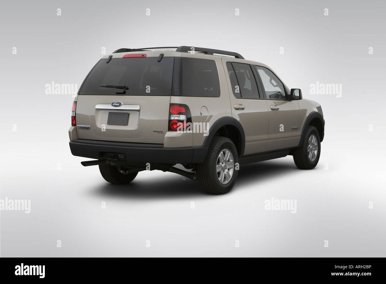 2007 ford explorer xlt in gold rear angle view