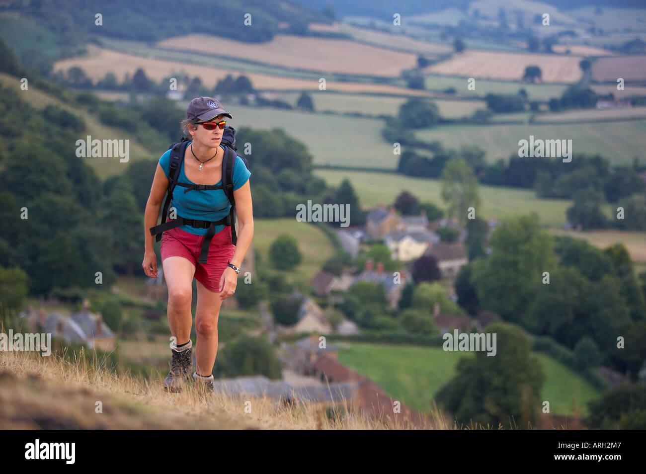 a woman hiking Somerset England UK MR - Stock Image