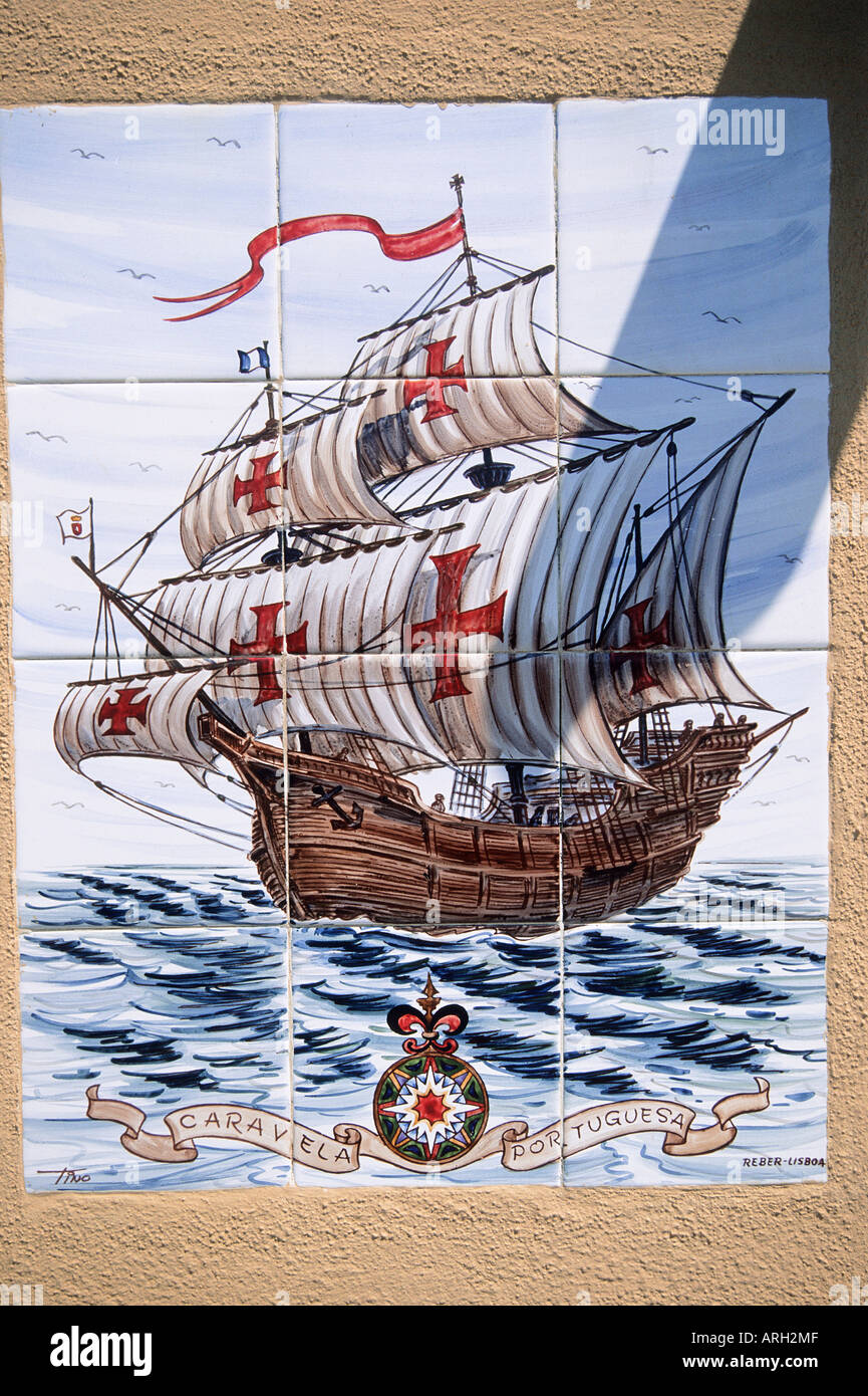 Decorative glazed tiles arranged in a panel illustrating a Portuguese caravel a lightweight trading ship of the 15th 17th centuries - Stock Image