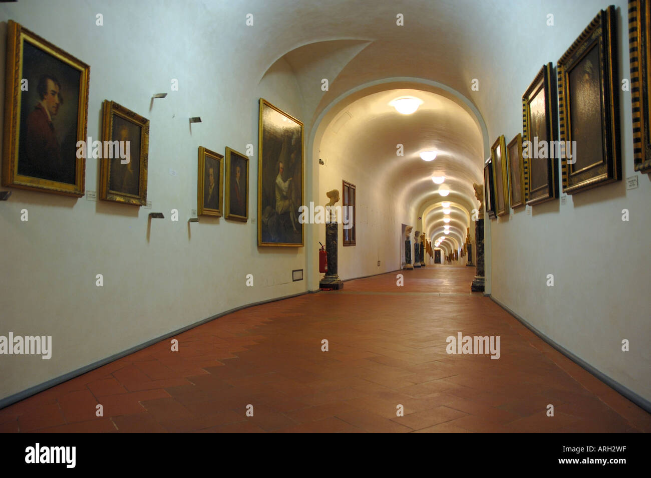 Looking along the Vasari Corridor which links the Uffizi Gallery and Pitti Palace in Florence Stock Photo