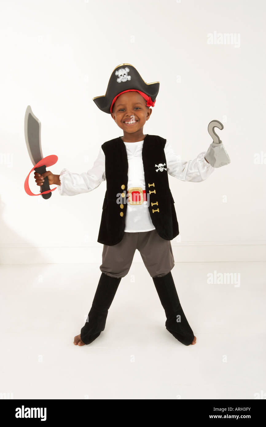 A boy plays dress up in a pirate outfit - Stock Image