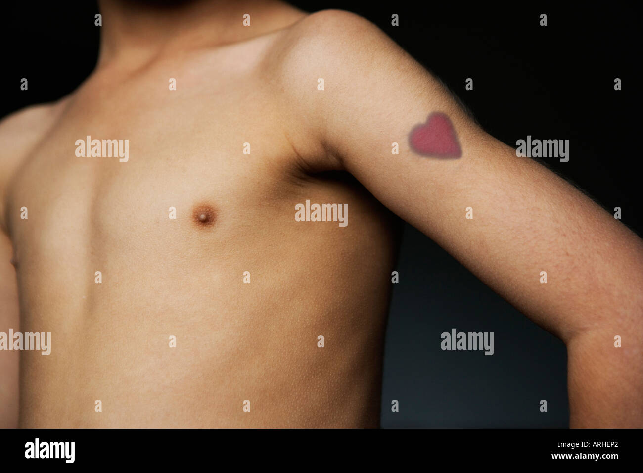 boy with bare chest and heart tattoo stock photo 9176033 alamy