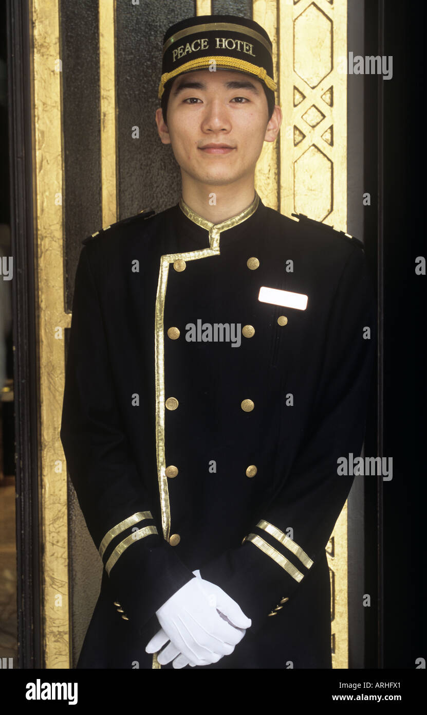 Door greeter at the Peace Hotel posing for the photograph The Bund Shanghai  sc 1 st  Alamy & Door greeter at the Peace Hotel posing for the photograph The Bund ...