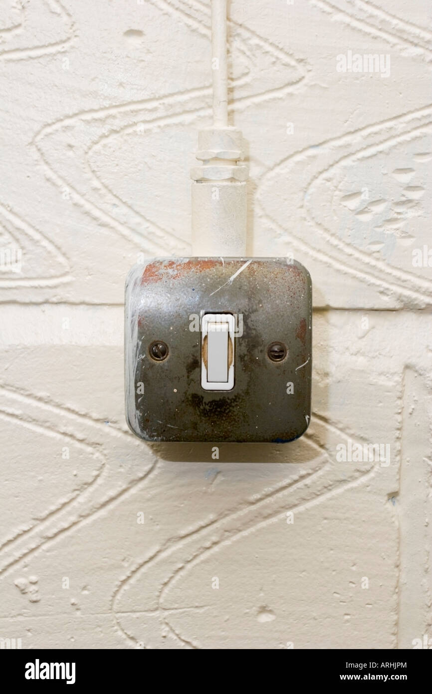 An industrial light switch on a white wall Stock Photo: 16059499 - Alamy