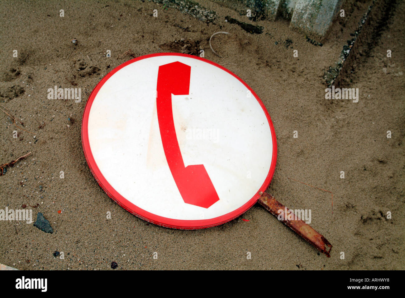 Symbol For Telephone Old Telephone Shield Sign Lying On The Ground