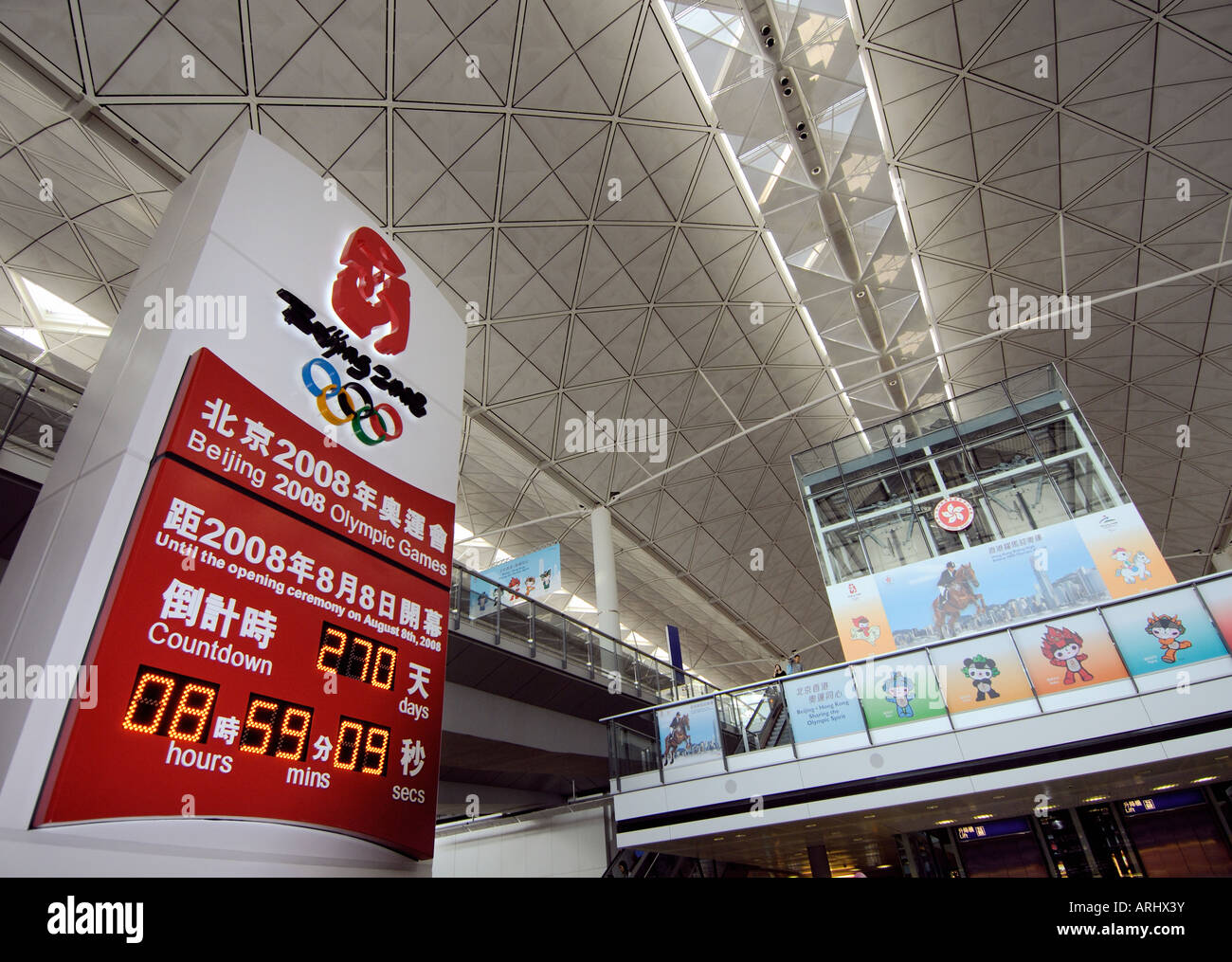 Beijing 2008 Olympics countdown board at airport. - Stock Image